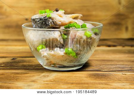 Marinated Carp In Glass Bowl On Wooden Table