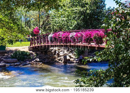 Walking Bridge Over Truckee River In Downtown Reno, Nevada