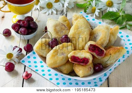 Fried Pies. Pies Sweet With Cherries On The Kitchen Table In A Rustic Style.