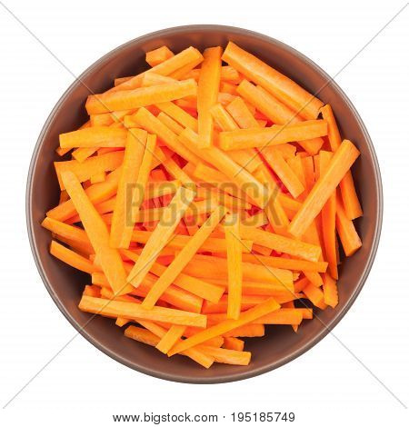 Ceramic bowl with chopped carrots isolated on white background top view