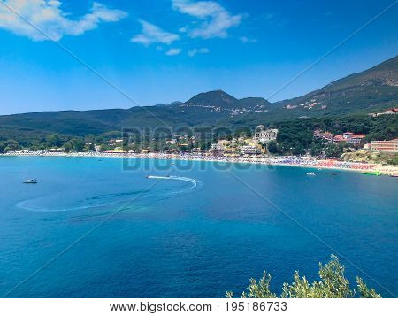 Summer vacation aerial view with turquoise sea water bay, beach and boats near Parga, Greece