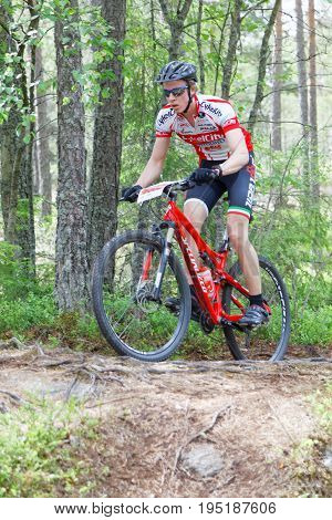STOCKHOLM SWEDEN - JUNE 11 2017: Front view of single mountain bike cyclists in the forest at Lida Loop Mountain bike Race. June 11 2017 in Stockholm Sweden