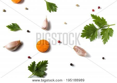 Parsley leave with garlic carrot and colored peppercorns isolated on white background - top view