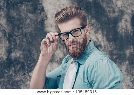 Successful Young Stylish Bearded Freelancer In Glasses Outdoors. He Looks Harsh And Fashionable