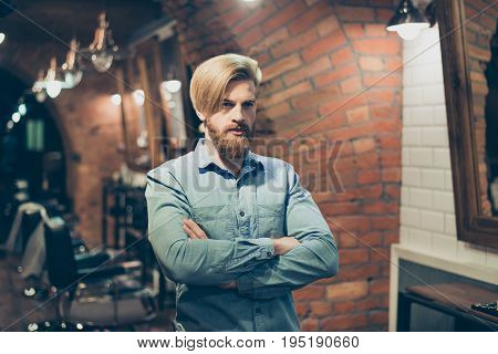Close Up Of A Stunning Look Of A Red Bearded Blond Guy With Trendy Hairdo In A Barber Shop. Looking