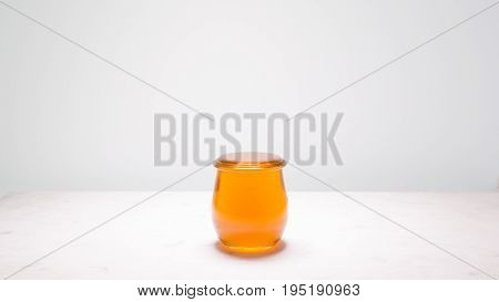 Honey that has been poured into a jar until it is filled to the brim just before overflowing. Suitable to represent that life is full and sweet.