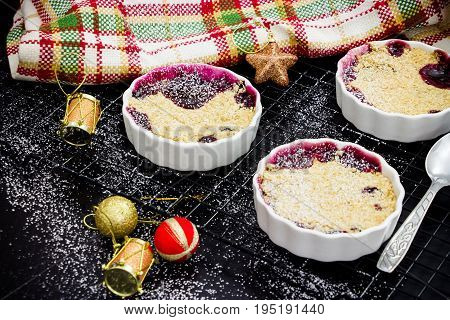 Homemade Delicious Oatmeal Crumble With Berries In Portioned Individual Ramekins. Healthy Breakfast.