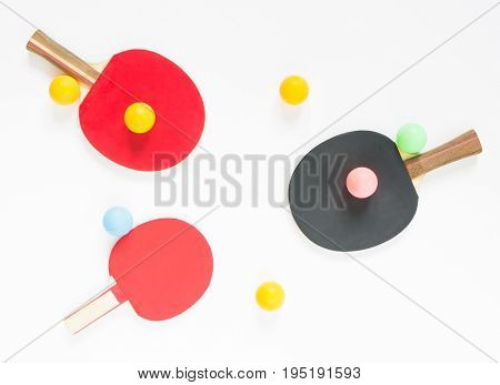 Sport background. Red and black ping-pong rackets and balls. Flat lay top view.