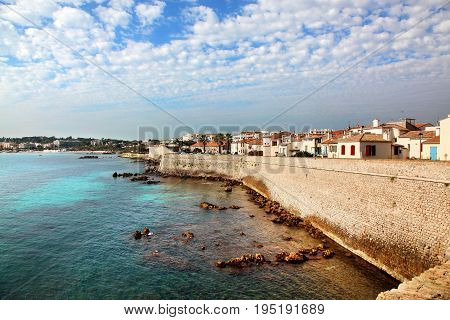 View of the historic harbor and seawall of Antibes France