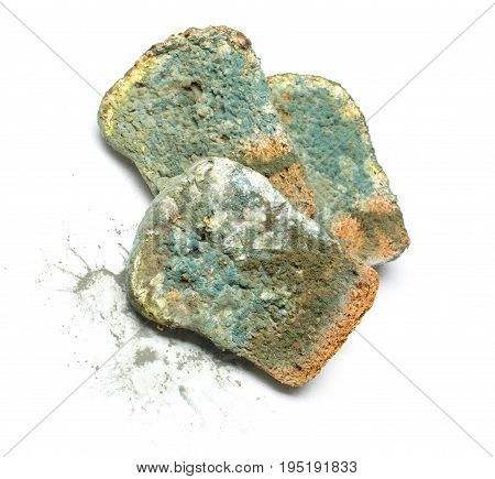 slices of bread covered with mold on white background.. with clipping path