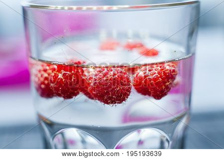 Sparkling raspberry lemonade water in a transparent glass