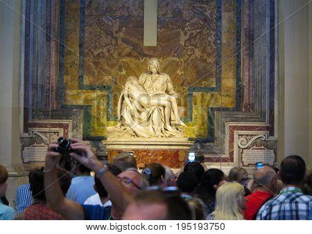 19.06.2017 St. Peter's Basilica Rome: A lot of tourists near the Michelangelo's Pieta sculpture