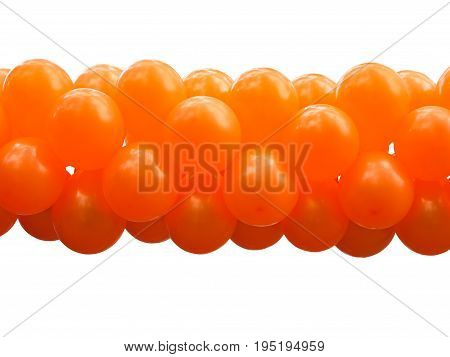 A bunch orange party balloons isolated on white
