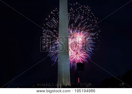 Fireworks light the night sky behind the Washington Monument on July 4 2017.
