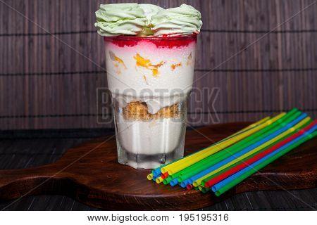 Homemade ice cream with ziifir and raspberry jam