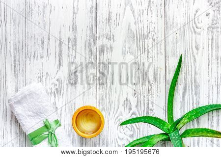 Skin care. Aloe vera gel and aloe vera leafs on wooden background top view.