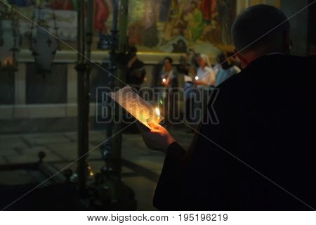 Prayer in the temple of the Holy Sepulcher in Jerusalem