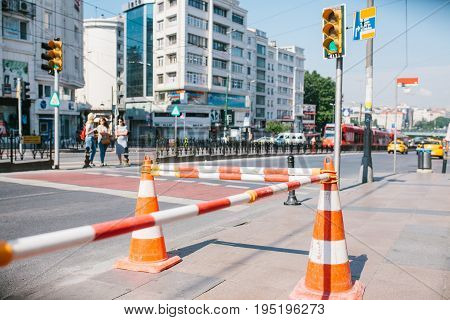 Road cone on the road. Road sign. Road works on the streets of Istanbul in Turkey. Sign.