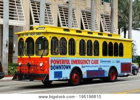 FORT LAUDERDALE, FL, USA - DEC. 26, 2014: Fort Lauderdale Hop on Hop off tour bus in downtown Fort Lauderdale, Florida, USA.