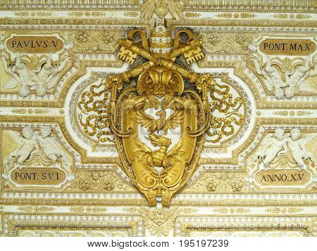 Coat of arms of the Vatican symbol bas-relief in of St. Peters Basilica