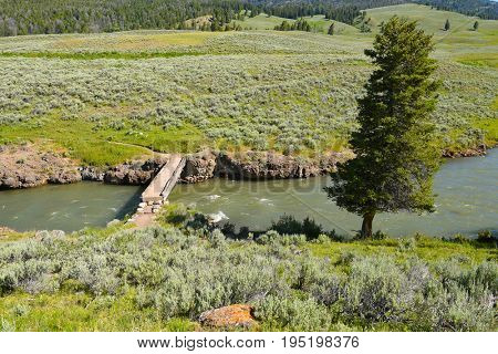 Footbridge at the Lamar River Trailhead in the Lamar Valley of Yellowstone National Park.