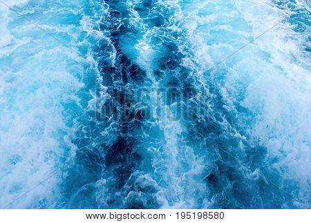 Sea water ship trail with white foamy wave. Tropical islands ferry travel. Bubble tail after cruise ship. Deep ocean view. Big ship pitching image. White water wave in the sea. Exotic island hopping