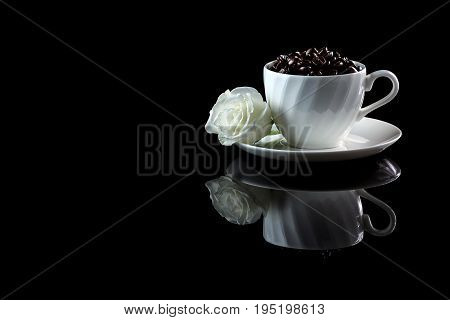 Cup With Coffee Beans And White Rose On A Black Reflective Background