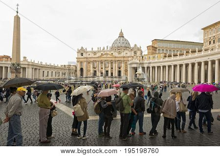 Vatican city, Vatican city state - October 02: Tourists with umbrellas in queue at the Vatican City State on October 02 2015