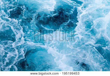 Sea ship trail with foamy wave. Tropical islands ferry travel. Cruiseliner seawater trail. Deep ocean top view. Big ship pitching image. White swirl wave on sea surface. Marine travel banner template