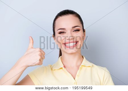 Close Up Of Young Gorgeous Toothy Girl, Standing On The Pure Light Blue Background And Smiling, Wear