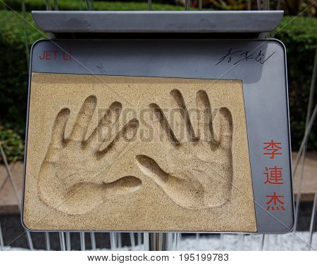 HONG KONG, CHINA - APRIL 16, 2017: Handprints and signature of Jet Li, a famous movie star, from Avenue of Stars
