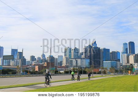 Cyclists and Melbourne downtown cityscape Melbourne Australia