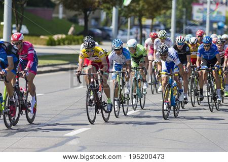 Minsk Belarus-July 8 2017: Group of Youth Road Cyclists in Professional Peloton During International Road Cycling Competition Grand Prix Minsk-2017 on July 8 2017 in Minsk Republic of Belarus.