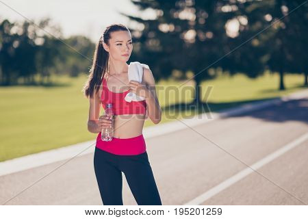 Attractive Young Trainer Finished Jogging And Drinking Water. She Is Outside On A Summer Stadium, Wi