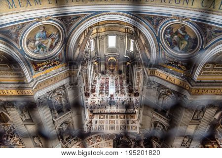 Rome Italy - August 19 2016: High angle view of the interior of St Peters Cathedral from the dome. The Papal Basilica of St. Peter in the Vatican is an Italian Renaissance church in Vatican City the papal enclave within the city of Rome.