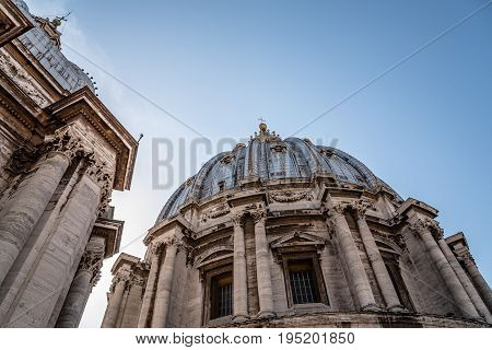 Rome Italy - August 19 2016: Exterior view of a Dome in the Basilica of St Peter. Low angle view. The Papal Basilica is an Italian Renaissance church in Vatican City the papal enclave within the city of Rome.