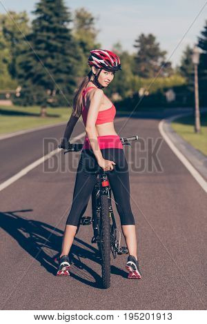 Catch Me If You Can! Young Cute Sport Lady In Trendy Outfit, Helmet And Sneakers Is Riding Her Bike,