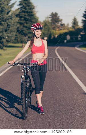 Fit Sportwoman Is Outside On A Summer Day, Finished Cicling On Modern Bike, Walking With It, In Fash