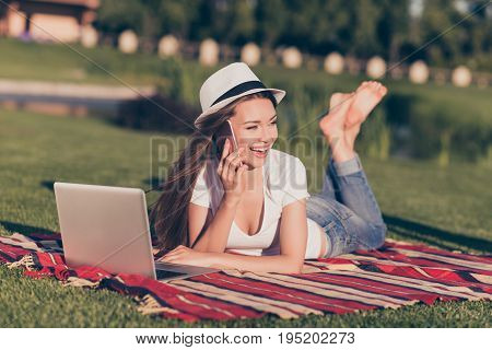 Cheerful Young Cute Tourist In A Hat, Talking On Her Pda, Lying On Plaid, In Casual Outfit And Hat,