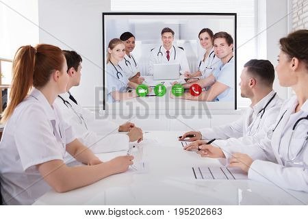 Group Of Professional Doctor's Having Video Conference In Meeting