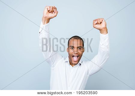 Attractive Amazed African Man, So Shocked, Extremely Happy, With Wide Open  Mouth On Pure Grey Backg