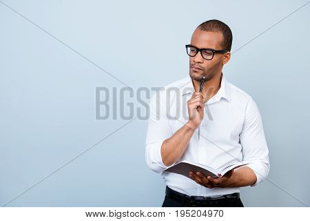 Idea Imagination And Inspiration Concept. Nerdy Academic African Professor Is Thoughtful, In Glasses