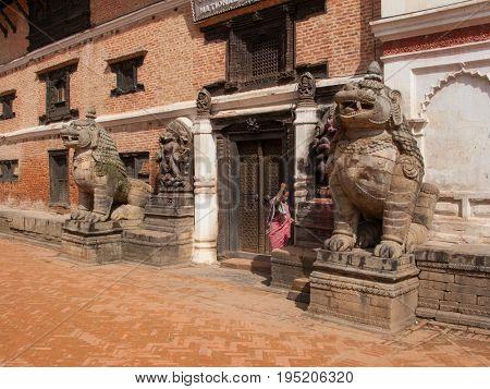 KATHMANDU, BHAKTAPUR, NEPAL. 30 September 2008: Ancient stone lions  in the Durbar square in Bhaktapur.