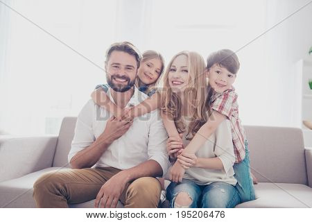 Family Portrait Of Four. Happy Parents Are Piggy Backing  Thier Cheerful Kids -  Blond Small Girl, B