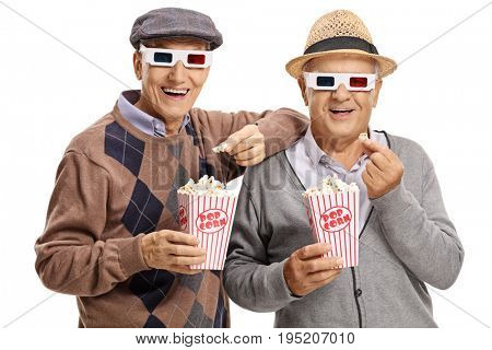Two elderly men wearing 3D glasses and having popcorn isolated on white background