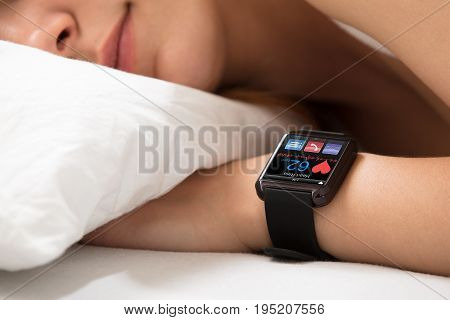 Smart Watch Showing Heartbeat Rate On Sleeping Woman's Hand