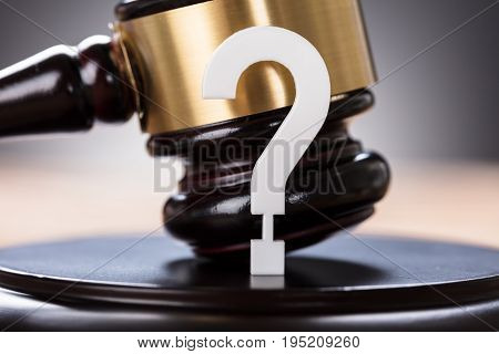 Closeup of question mark and auction gavel