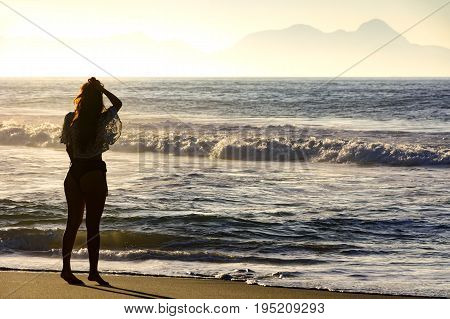 Young girl at summer sunset in Ipanema beach Rio de Janeiro