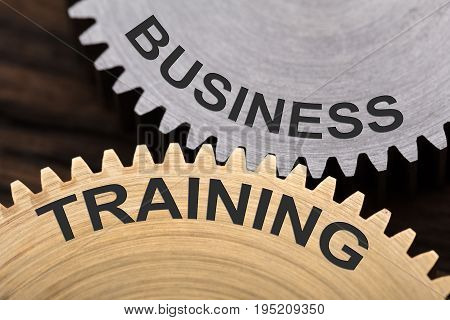 Closeup of business training concept on interlocked cogwheels