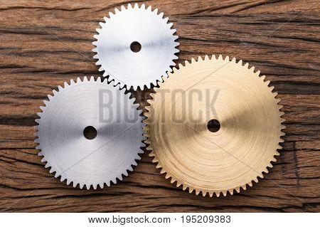 Closeup photo of three interlocking metal gears